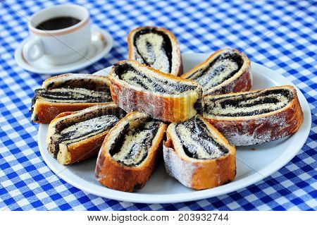 Sweet strudel with poppy seeds on the plate