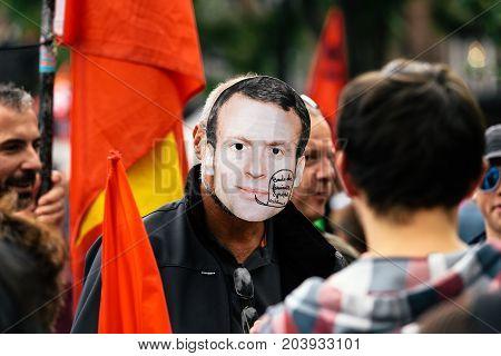 Man Wearing Emmanuel Macron Mask At Protest