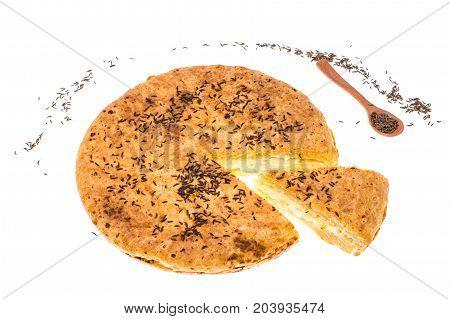 Homemade pie with cumin on white background. Studio Photo