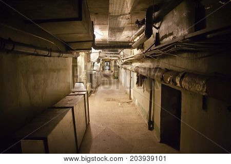 Underground cellar with water heating pipes and cables