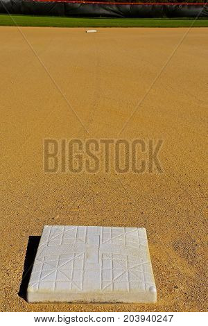 Second base is seen 90 feet down the line from third base on a baseball diamond