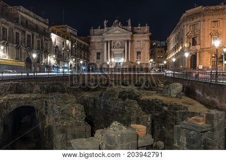 Night view of the church of San Biagio, in Catania; in the foreground a glimpse of the roman amphitheatre