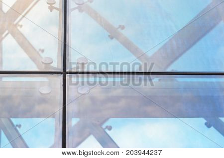 Fastening of Glass on the Facade Close-Up. Spider facade fixing system. Abstract Architecture Background poster