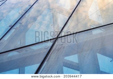 Fastening of Glass on the Facade Close-Up. Spider facade fixing system. Abstract Architecture Background