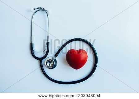 close up red heart and stethoscope on white background world health day concept process vintage tone