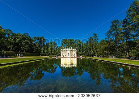 ST.PETERSBURG/RUSSIA - JULY 26, 2017.  Mirror pond and pavilion Upper bath in Yekaterinsky Park of Tsarskoye Selo in the vicinity of St. Petersburg