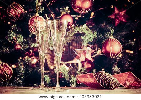 Getting Ready! Two Empty Glasses With Christmas Tree Background And Sparkles. Holiday Season Backgro
