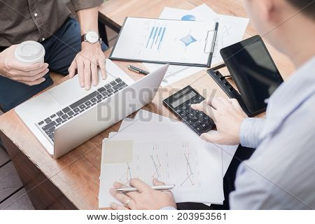Administrator business man financial inspector and secretary making report calculating or checking balance. Internal Revenue Service inspector checking document. Audit concept.