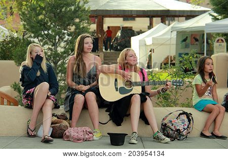 TAOS, NEW MEXICO - OCTOBER 1, 2011: Group of young women in the center of Taos, New Mexico