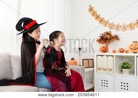 Mother Helping Her Daughter To Dress Up