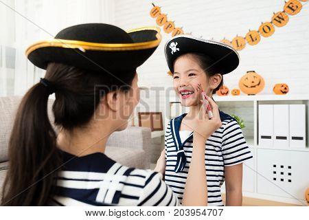 Girl And Mother Play Halloween Makeup