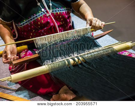 Local woman is making handicraft work with local loom