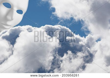 White mask above fluffy clouds looking down. Divine intervention concept