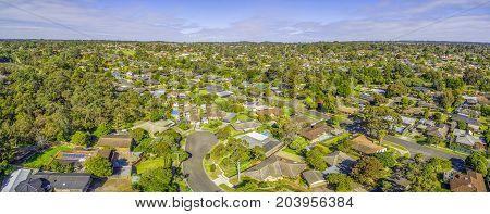 Suburbian houses in Australia. Aerial panorama on bright sunny day