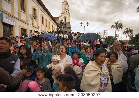 April 14 2017 Cotacachi Ecuador: spectators watching the annual Easter celebration procession in the indigenous Andean town