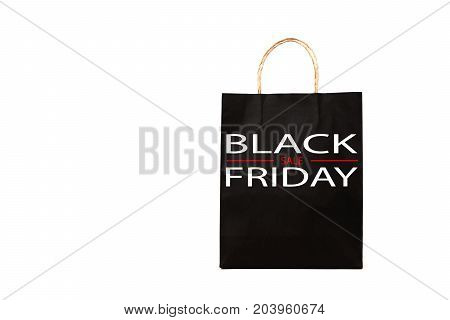 black paper bag with black friday word on white background.