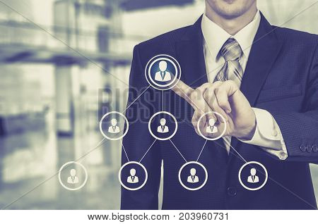 Human resource business concept. Businessman presses hr icon on virtual screen.