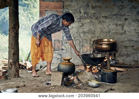 Naggar, India - July 17: Cooking Indian. Hindu Man Preparing Food For A Traditional Wedding Ceremony