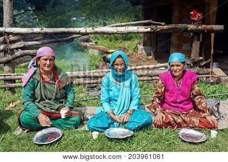 Naggar, India - July 17: Indian Woman Waiting For A Special Food - Prasadam. Prasad Ritual Food Cook