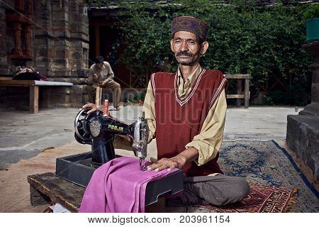 Naggar, India - July 17: Traditional Indian Tailor. Posing For Photography. July 17, 2013 In Naggar,