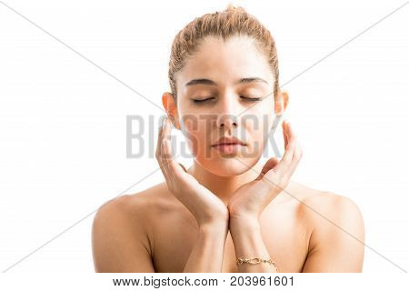 Woman With Her Hands Close To Her Face