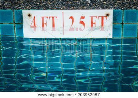 Pool Depth Sign At The Edge.