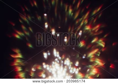Abstract blurred glittering background of rainbow colorful flare. Blur light bokeh. Festive wallpaper of sparkle spatters, holiday and celebration decoration concept