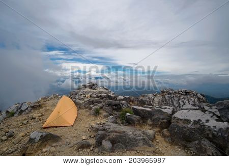 Camping Tent At The Edge Of The World. Summit Of Sibayak Volcano, Sumatra, Indonesia