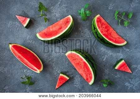 Watermelon on dark table. Sliced watermelon on black background. Flat lay top view