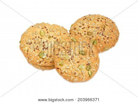 Savory cookies sprinkled with sesame seeds flax seeds pumpkin seeds and sunflower on a white background