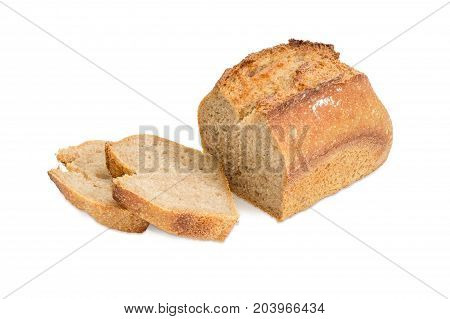 Partially cut loaf and two slices of the wheat sourdough bread on a white background