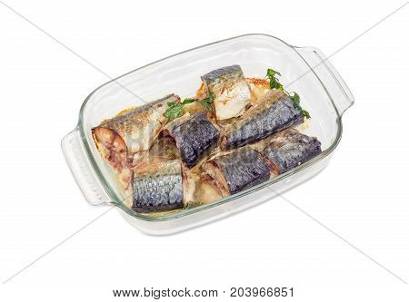 Baked pieces of Atlantic chub mackerel in the rectangular glass pan for baking on a white background