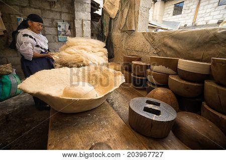 April 21 2017 Iluman Ecuador: wool hat and press forms on work bench in artisan shop