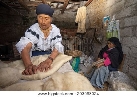 April 21 2017 Iluman Ecuador: kichwa indigenous women working at an artisan hat shop