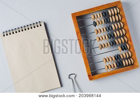 Old wooden abacus on grey background. The concept of bookkeeping business or saving money