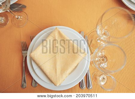beautiful table setting in a restaurant. Dishesforks and glasses. View from above