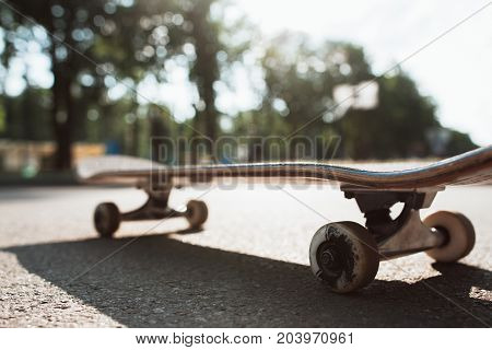 One skateboard on the road. Extreme sport challenge and skateboarder competition, close up picture of skate