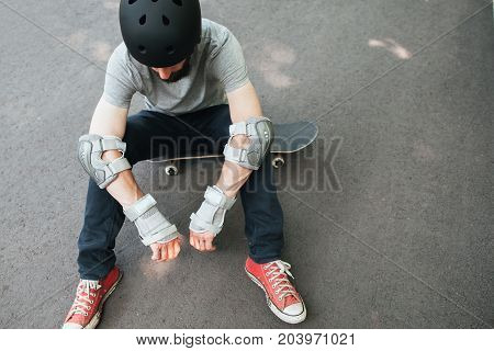 Professional skater has bad day in competition, crash and failure on training, exhaustion and refreshment concept