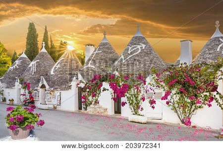 Trulli houses in Alberobello city at sunset time Apulia Italy.