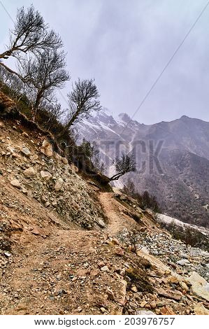 Country road in the mountains whit cloudy sky. Himalaya mountains. Uttarakhand Gangotri India.