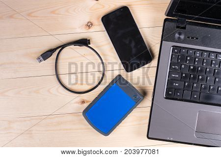 Flat Lay Above Lap Top Computer Keyboard And External Hard Disc And Mobile Phone With Copy Space