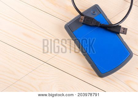 Flat Lay Above External Hard Disc Hdd On The Wooden Board Table With Copy Space