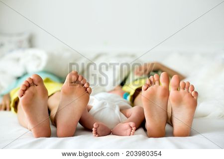 Little Baby Boy Feet, Baby Lie Down In Bed In The Afternoon
