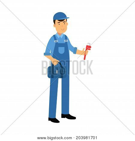 Proffesional plumber character in a blue overall standing with monkey wrench and tool box, plumbing service vector Illustration on a white background