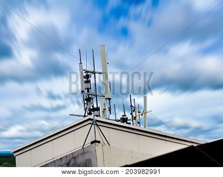 Radio Reception Antenna Installed On A High Roof. Abstract Isolate