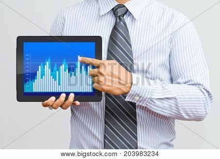 businessman present rising graph on tablet screen, business growth