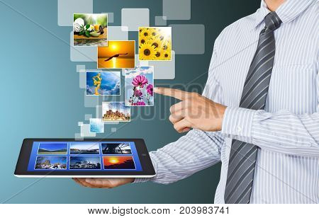 businessman present screen tablet device with images