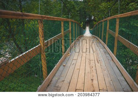 Suspension bridge over the river in a Carpathian mountains
