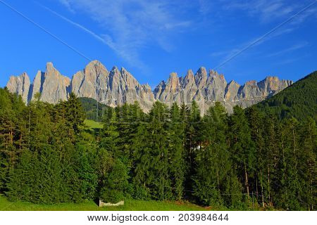 Santa Magdalena village in front of Dolomites Group, Val di Funes, Italy,