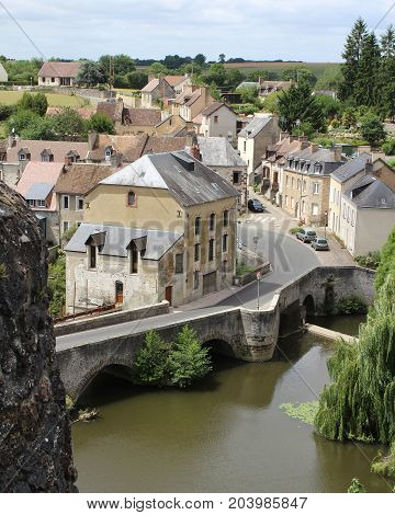 FRESNAY-SUR-SARTHE, JULY 14 2017: View of part of the town of Fresnay on the river Sarthe from the castle ruins. It is a small historic town in Pays de Loire, and a less well known tourist destination